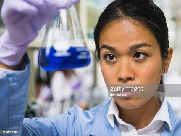 Japanese scientist working in laboratory