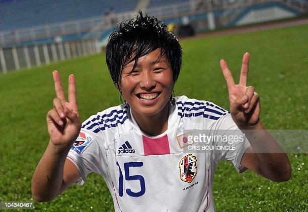 Japanese scoring player midfielder Hikari Tagaki flashes a victory sign after the FIFA Women's Under17 semifinal match against North Korea on...
