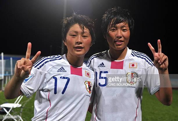 Japanese scoring players, forward Kumi Yokoyama and midfielder Hikari Tagaki flash a victory sign after the FIFA Women's Under-17 semifinal match...