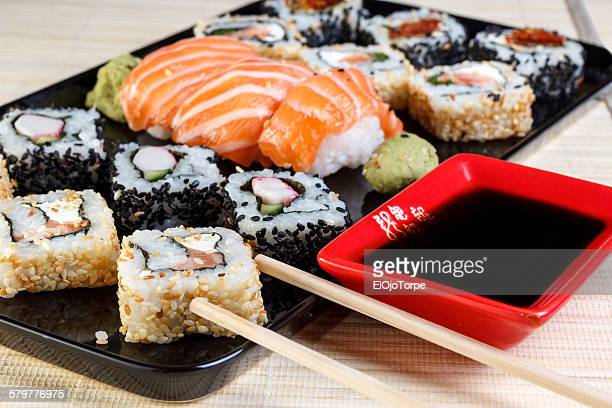 Japanese seafood sushi on a black plate