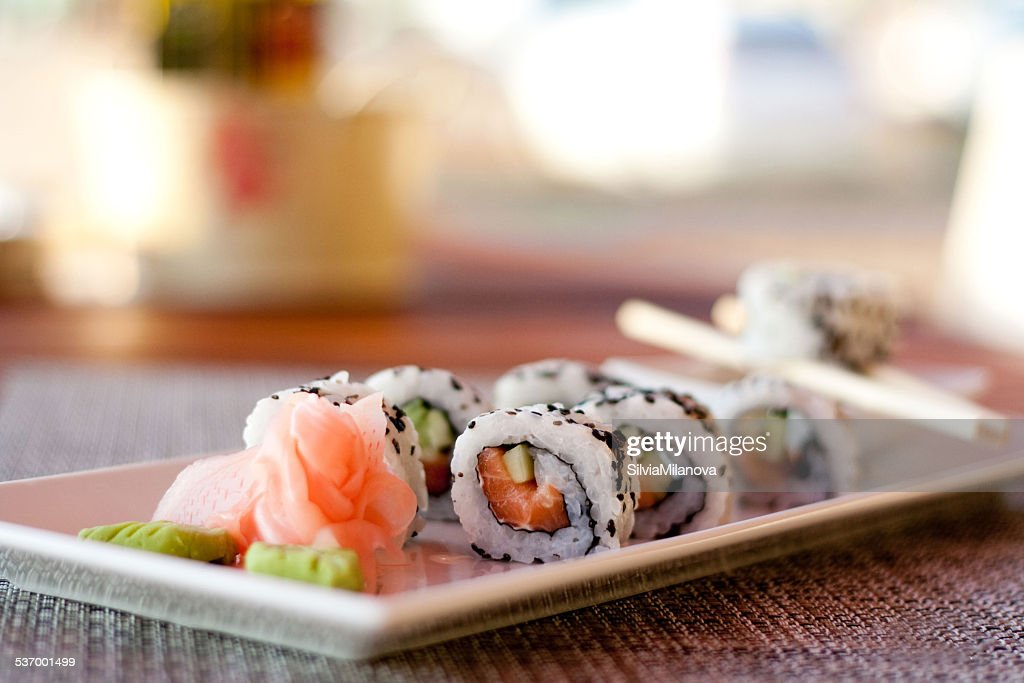 Japanese seafood sushi, roll and chopstick on white plate : Stock Photo