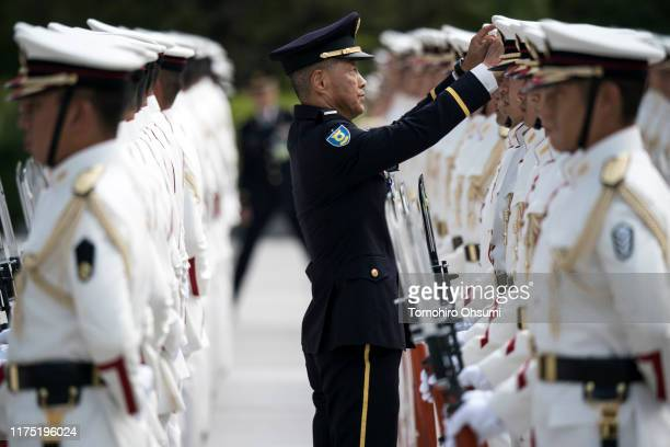 Japanese Self Defense Forces honor guard prepares for the inspection by Japan's Prime Minister Shinzo Abe at the Ministry of Defense on September 17...