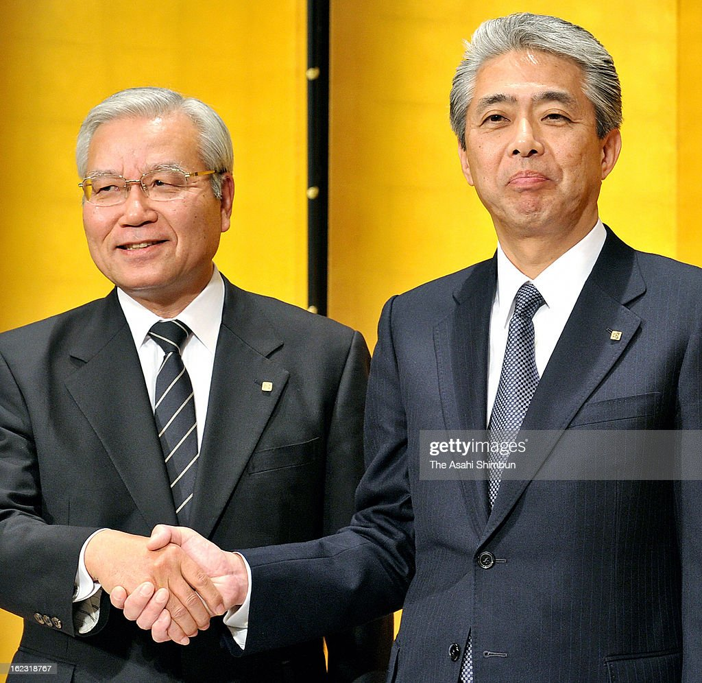 Japanese semiconductor maker Kyocera new President Goro Yamaguchi (R) and President Tetsuo Kuba listens during a press conference on February 21, 2013 in Kyoto, Japan. Yamaguchi is officially appointed as president on April 1.