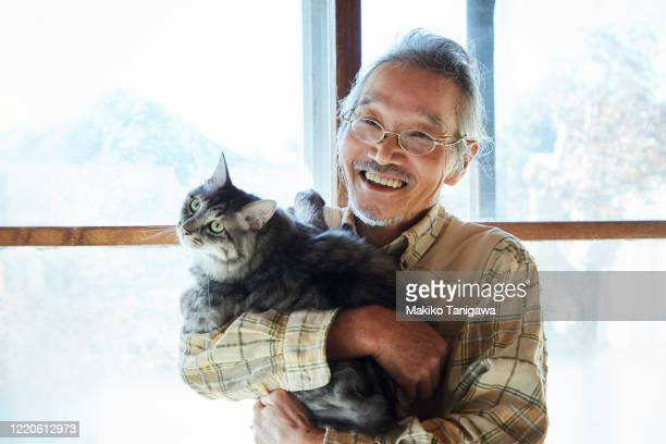 japanese senior man and his pet cat - disruptaging stock pictures, royalty-free photos & images