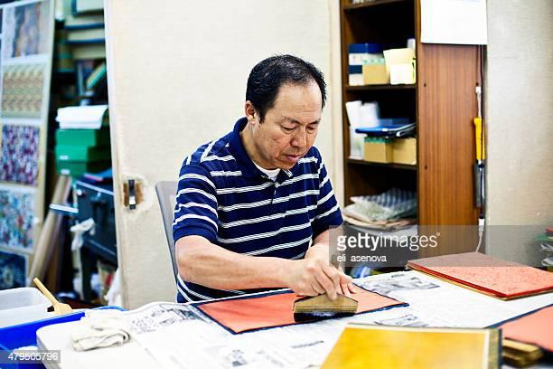 Japanese Senior man working handmade craft, Tokyo.