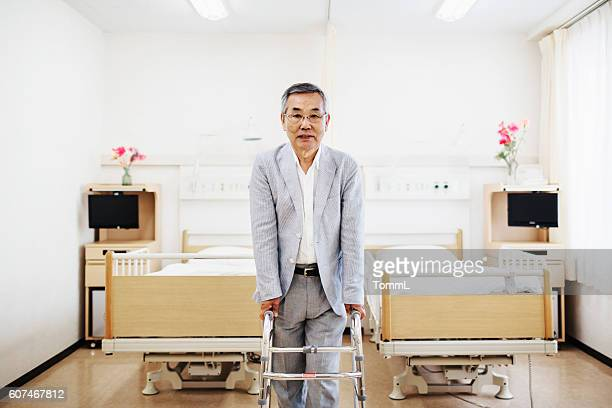 Japanese senior patient standing with walker