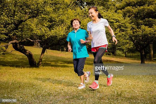 Japanese senior women running in the park