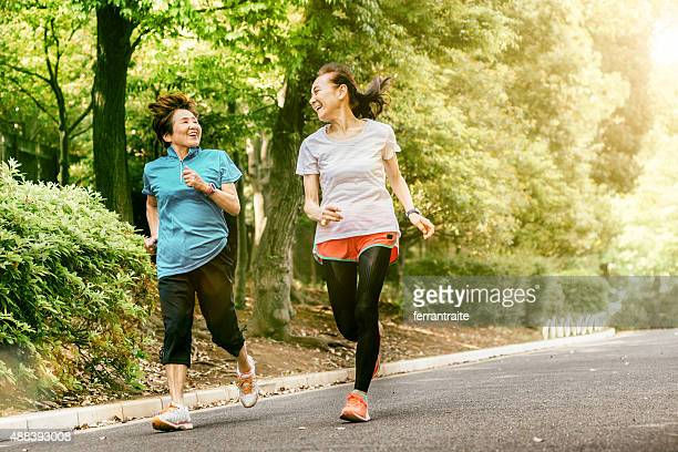 japanese senior women running - east asian culture stock photos and pictures