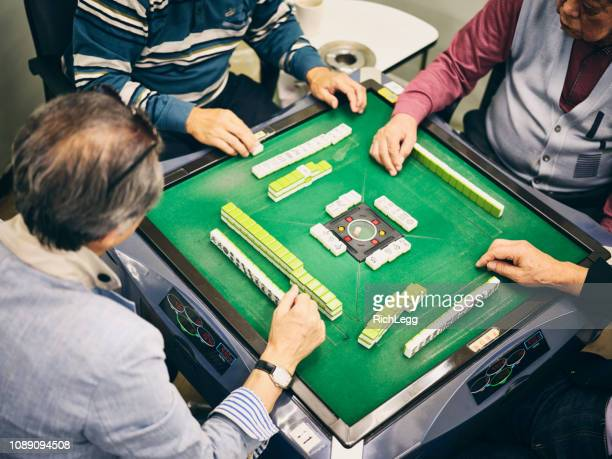 japanese seniors playing mahjong - gambling table stock pictures, royalty-free photos & images