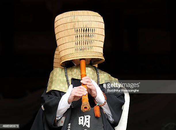 Japanese Shakuhachi player performs traditional bamboo flute during the Oni Oi annual festival at Masuiyama Zuiganji Temple on February 11 2104 in...