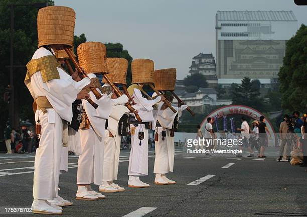 Japanese Shakuhachi players perform traditional bamboo flutes during the annual Himeji Castle Festival on August 3 2013 in Himeji Japan The parade of...
