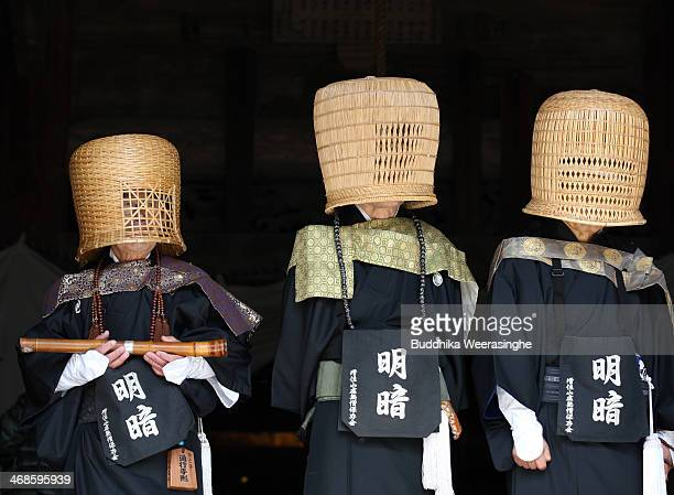 Japanese Shakuhachi players perform traditional bamboo flutes during the Oni Oi annual festival at Masuiyama Zuiganji Temple on February 11 2104 in...