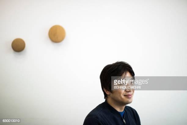 Japanese Shigetaka Kurita the man who created emoji charachters poses for a portrait in Tokyo on November 30 2016 Kurita was working at major telecom...