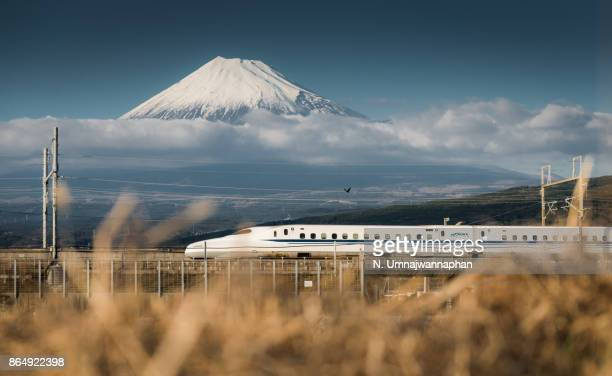 japanese shinkansen bullet train running in front of the mount fuji in shizuoka - shizuoka stock photos and pictures