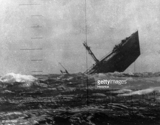 A Japanese ship sinking sternfirst after being torpedoed by the submarine USS Aspro   View from Periscope