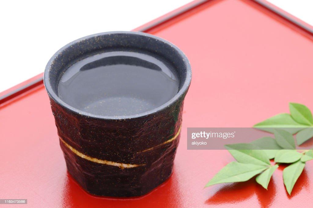 Japanese shochu and ceramic bowl : Stock Photo