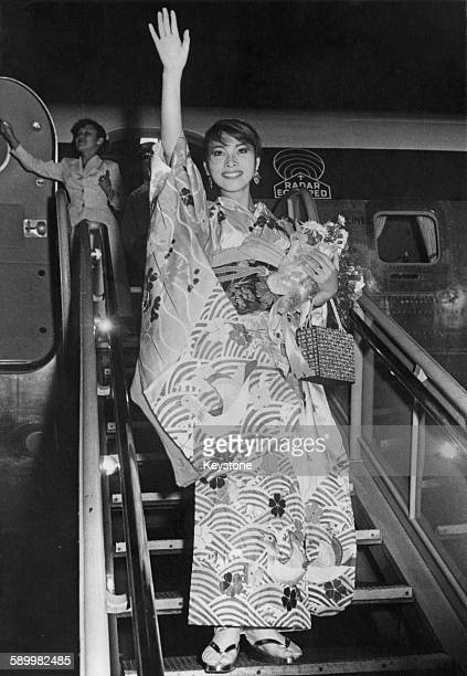 Japanese singer and actress Michiko Hamamura leaves Tokyo Japan for the United States to take part in 'The 'Big Record' a television show in New York...