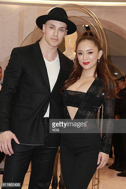 Japanese singer Ayumi Hamasaki and her husband attend commercial activity of La Perla on February 23 2016 in Hong Kong China