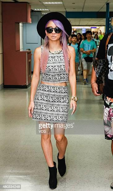 Japanese singer Koda Kumi poses at Taoyuan International Airport after arriving in Taipei on July 10 2015 in Taipei Taiwan of China