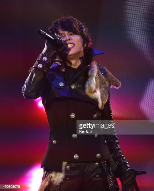 Japanese singer TMRevolution performs onstage during MTV Video Music Awards Japan 2014 at Maihama Amphitheater on June 14 2014 in Urayasu Japan