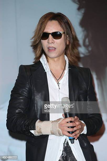 Japanese singer Yoshiki Hayashi of XJapan attends a press conference ahead of his concert at Humble House Hotel on June 12 2014 in Taipei Taiwan