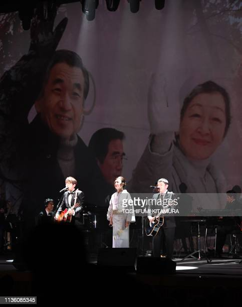 """Japanese singer Yumi Matsutoya and pop music duo """"Yuzu"""" perform during a ceremony to celebrate Emperor Akihito's 30-year reign in Tokyo on April 10,..."""