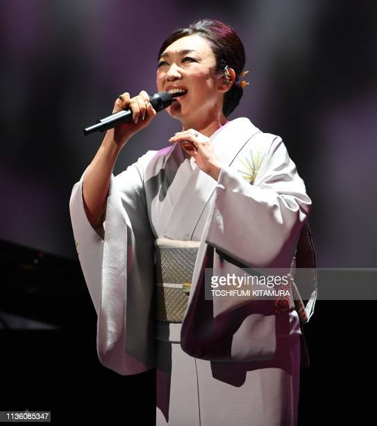 Japanese singer Yumi Matsutoya performs during a ceremony to celebrate Emperor Akihito's 30-year reign in Tokyo on April 10, 2019. - Japanese Emperor...