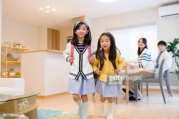 Japanese sisters was carrying a school bag