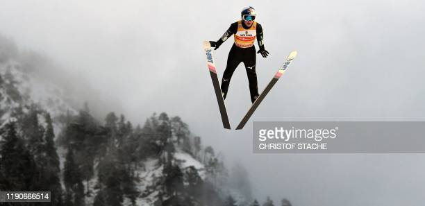 TOPSHOT Japanese ski jumper Ryoyu Kobayashi soars in the air during his second training jump at the FourHills Ski Jumping tournament on December 28...