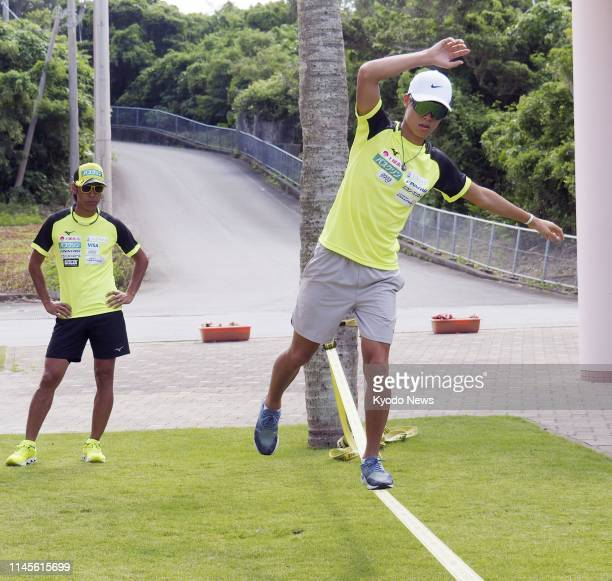 Japanese ski jumper Ryoyu Kobayashi trains in Miyakojima Okinawa Prefecture on May 23 as veteran jumper Noriaki Kasai looks on ==Kyodo