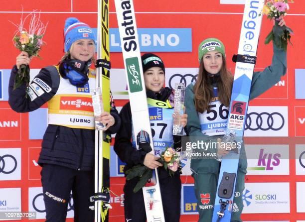 Japanese ski jumper Sara Takanashi celebrates after picking up her first World Cup win of the season on Feb 10 in Ljubno Slovenia alongside...