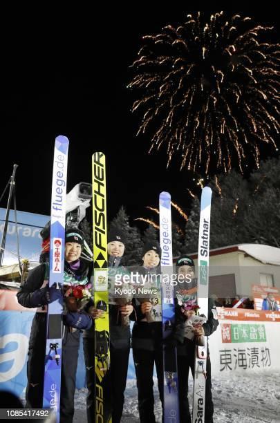 Japanese ski jumpers Yuki Ito Yuka Seto Kaori Iwabuchi and Sara Takanashi pose for photos after finishing third in a World Cup women's team event at...