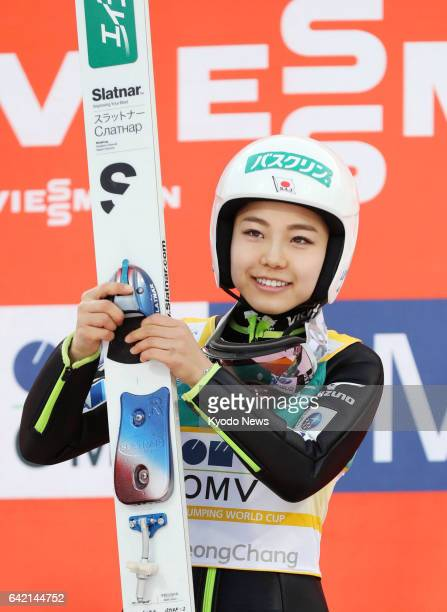 Japanese ski jumping superstar Sara Takanashi smiles after capturing the 53rd World Cup title of her career to tie Austrian Gregor Schlierenzauer's...