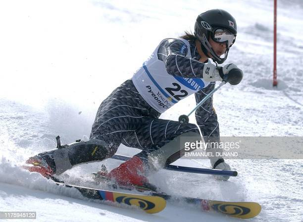 Japanese skier Akira Sasaki powers his way to seventeenth position, 02 March 2003, in the World Cup Men's Slalom in Yongpyong, some 250 kilometres...
