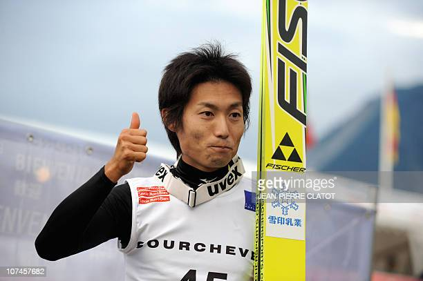 Japanese skier Daiki Ito jubilates after winning competes during the 2rd round of the FIS summer Grand Prix Ski Jumping on August 13 2010 in...