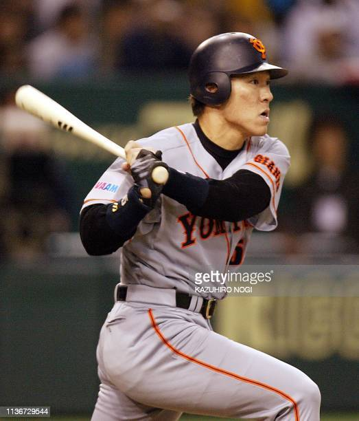 Japanese slugger Hideki Matsui of the Tokyo Yomiuri Giants follows after a two-base hit during a game between Japanese baseball squad and the Major...