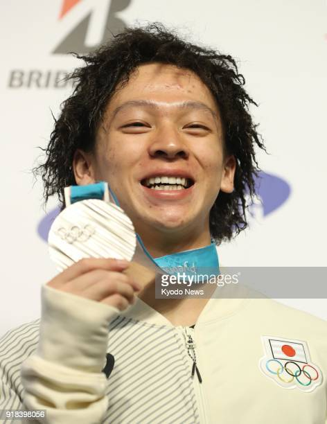 Japanese snowboarder Ayumu Hirano smiles with his Pyeongchang Winter Olympics halfpipe silver medal in Pyeongchang South Korea on Feb 15 2018 ==Kyodo