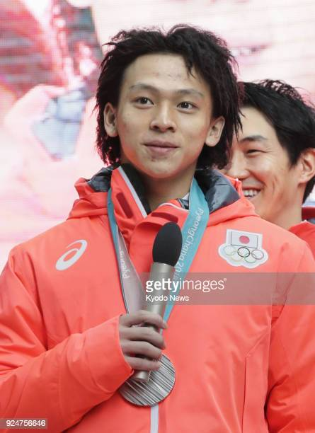 Japanese snowboarder Ayumu Hirano who won the silver medal in the Pyeongchang Olympics men's halfpipe speaks at a meeting held in front of fans in...