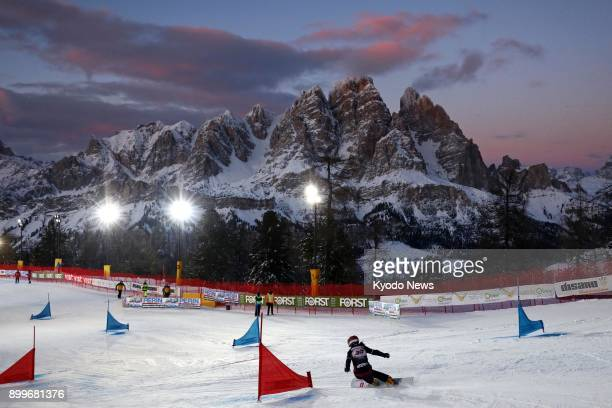 Japanese snowboarder Eri Yanetani is pictured competing in a women's parallel slalom race at a World Cup meet in Cortina d'Ampezzo Italy on Dec 16...