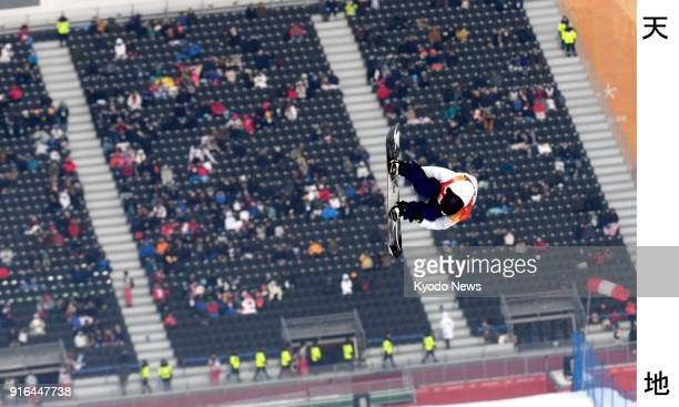 Japanese snowboarder Hiroaki Kunitake performs in the men's slopestyle qualification heat at the Pyeongchang Winter Olympics in South Korea on Feb 10...