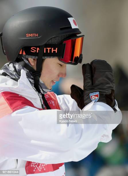 Japanese snowboarder Hiroaki Kunitake reacts after finishing his first run in a men's big air qualification heat at the Pyeongchang Winter Olympics...