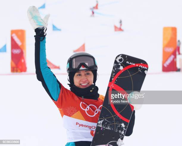 Japanese snowboarder Tomoka Takeuchi acknowledges the crowd after competing in a women's parallel giant slalom elimination race at the Pyeongchang...