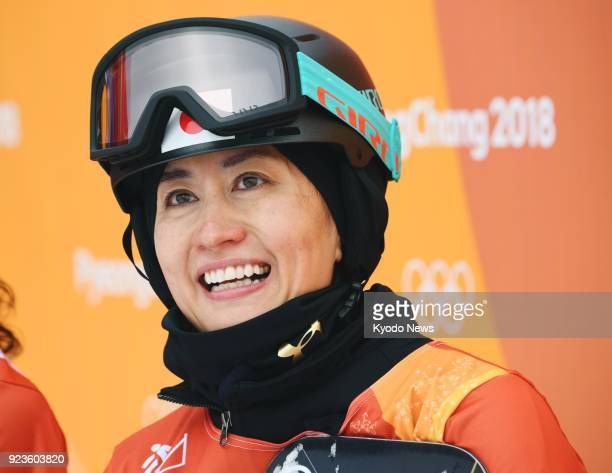 Japanese snowboarder Tomoka Takeuchi smiles after competing in a women's parallel giant slalom elimination race at the Pyeongchang Winter Olympics in...