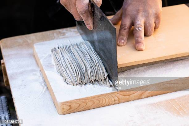 japanese soba made by professional craftsmen. put the water in buckwheat flour, stretch the dough with a noodle stick and cut it up with a kitchen knife. - buckwheat stock pictures, royalty-free photos & images