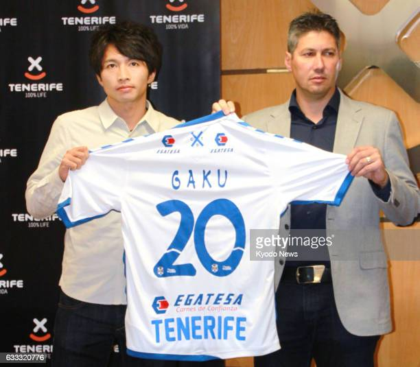 Japanese soccer player Gaku Shibasaki poses with his uniform during a press conference in Tenerife Spain on Feb 1 after the 24yearold midfielder...