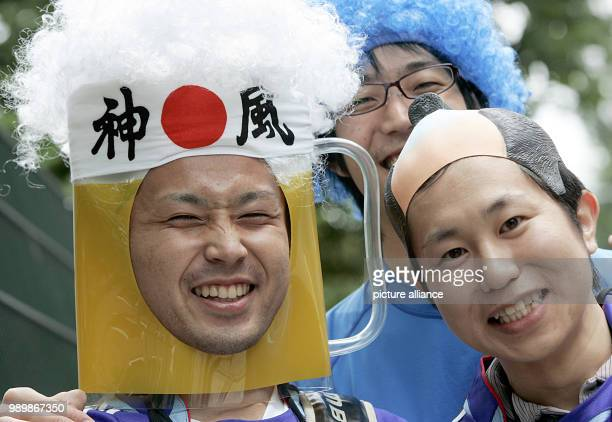 Japanese soccer supporters cheer prior to the group E preliminary match of 2006 FIFA World Cup between Czech Republic and Italy in Hamburg on...