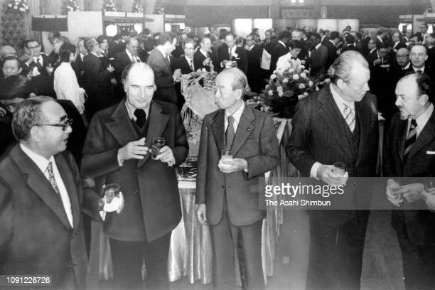 Japanese Socialist Party Chairman Ichio Asukata First Secretary of the Socialist Party of France Francois Mitterrand Japanese Prime Minister Takeo...
