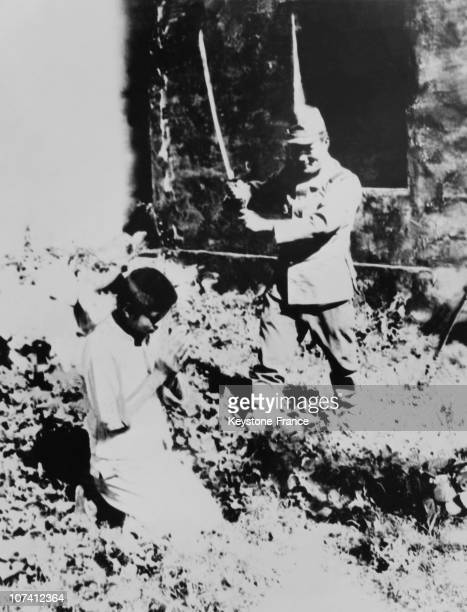 Japanese Soldier Decapitating A Young Chinese Peasant On August 1938