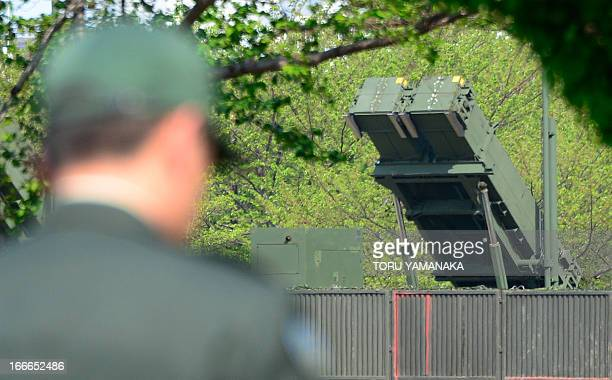 A Japanese soldier walks past a Patriot Advanced Capability3 missile launcher deployed at the Defence Ministry in Tokyo on April 15 2013 US Secretary...