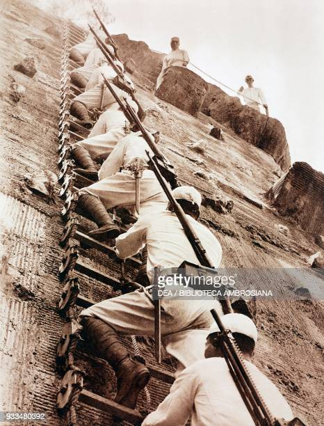 Japanese soldiers assaulting a stronghold on a scaling ladder during exercises, Japan, photograph from The Illustrated London News, January 19, 1935.